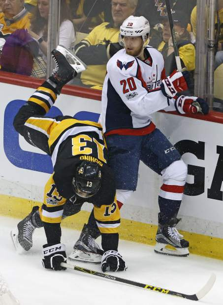 Pittsburgh Penguins' Nick Bonino (13) is upended as he collides with Washington Capitals' Lars Eller (20) during the first period of Game 3 in an NHL Stanley Cup Eastern Conference semifinal hockey game in Pittsburgh, Monday, May 1, 2017. The Capitals won 3-2 in overtime. (AP Photo/Gene J. Puskar)