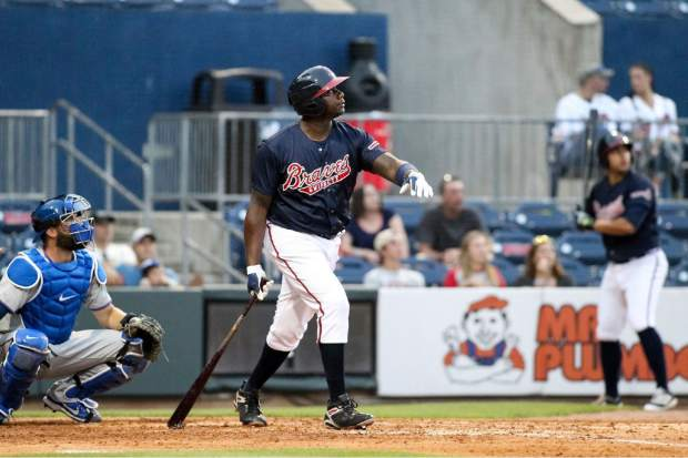 In this photo taken Wednesday, May 3, 2017, and provided by the Gwinnett Braves, Gwinnett Braves' Ryan Howard watches his two-run home run during the fourth inning of a minor league baseball game against the Durham Bulls in Gwinnett, Ga. Howard is an MVP, a World Series champion and once one of baseball's most feared sluggers. So what's he doing in the minor leagues at age 37?