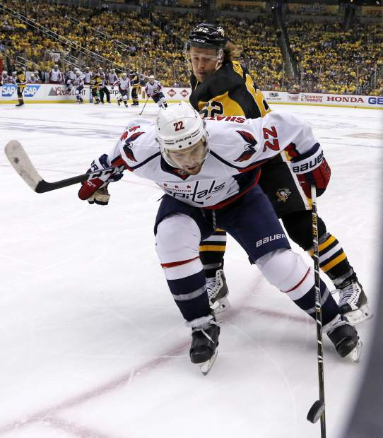 Washington Capitals' Kevin Shattenkirk (22) battles with Pittsburgh Penguins' Carl Hagelin (62) for control of the puck during the second period of Game 6 in an NHL Stanley Cup Eastern Conference semifinal hockey game in Pittsburgh, Monday, May 8, 2017. (AP Photo/Gene J. Puskar)