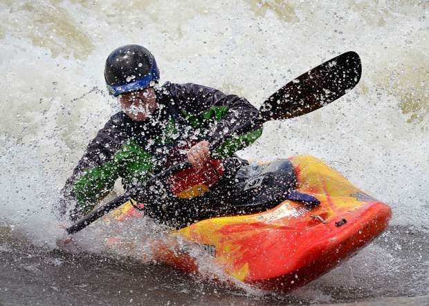 When the water is up and the weather is warm, Glenwood Springs's play wave draws the kayakers out to practice their moves.