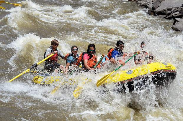 Commercial boaters get a face-full of white water in Shoshone on Tuesday.