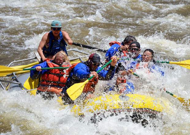 A commercial Whitewater Rafting trip takes an early season run down Shoshone Tuesday.