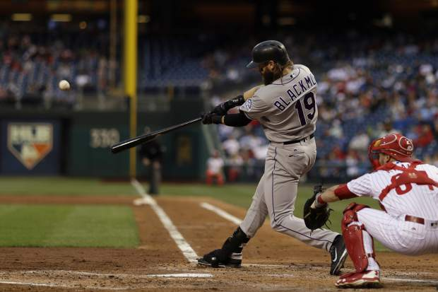 Colorado Rockies' Charlie Blackmon, left, hits a two-run home run off Philadelphia Phillies starting pitcher Zach Eflin during the third inning of a baseball game, Tuesday, May 23, 2017, in Philadelphia. At right is Andrew Knapp. (AP Photo/Matt Slocum)