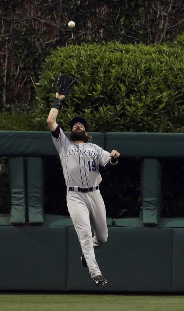 Colorado Rockies center fielder Charlie Blackmon catches a line out by Philadelphia Phillies' Freddy Galvis during the third inning of a baseball game, Tuesday, May 23, 2017, in Philadelphia. (AP Photo/Matt Slocum)