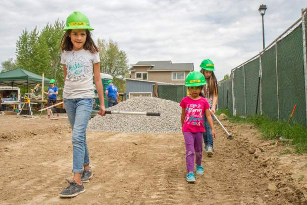 Sisters Natalie, left, Ruby and America Meraz volunteer to build their future home in Silt.
