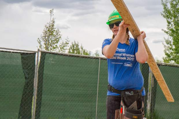 Volunteer Shelly Davies helps out at the Silt jobsite on Saturday during National Women Build Week.