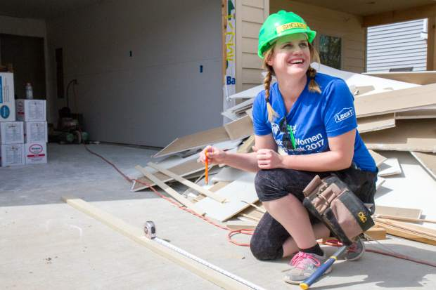 Volunteer Shelly Davies has fun with other volunteers at the Silt jobsite where a duplex is being built for two families.