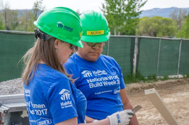 Renae May, left, an Nora Meraz work together on the Silt jobsite where a duplex is being built for families.