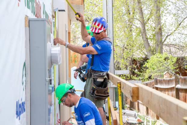 Habitat for Humanity Construction Supervisor Ron Acee works with Juan Villanueva to take measurments for duplex being built for two families in Silt.