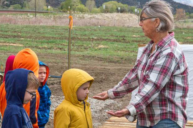 Co-found Sarah Rumery explains to a group of kindergartners the benefit of using organic compost during a farm tour.