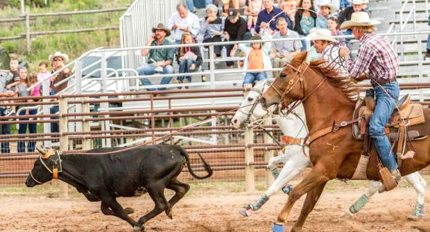 Team ropers Max Macinelle and Court Will compete during slack events at last year's Carbondale rodeo. The slack rodeo is for the