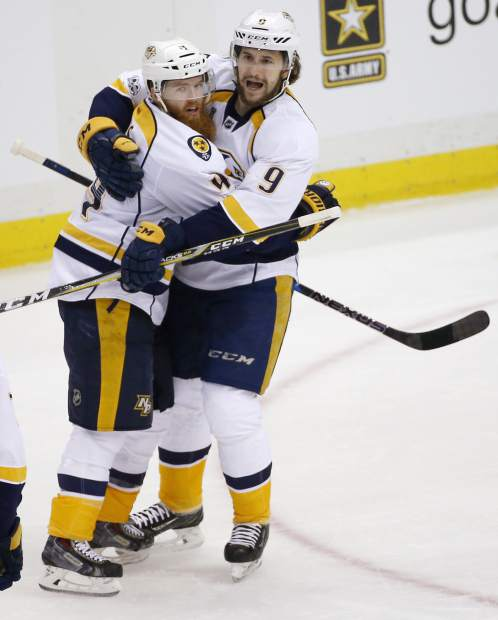 Nashville Predators' Ryan Ellis, left, celebrates his goal against the Pittsburgh Penguins with Filip Forsberg, right, during the second period in Game 1 of the NHL hockey Stanley Cup Finals on Monday, May 29, 2017, in Pittsburgh. (AP Photo/Gene J. Puskar)