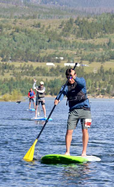 SUPers race along the water at Lake Dillon during the 2016 Frisco Triathlon. Local SUP instructors suggest yoga and core training in May to prepare for flat water and whitewater SUP this summer.