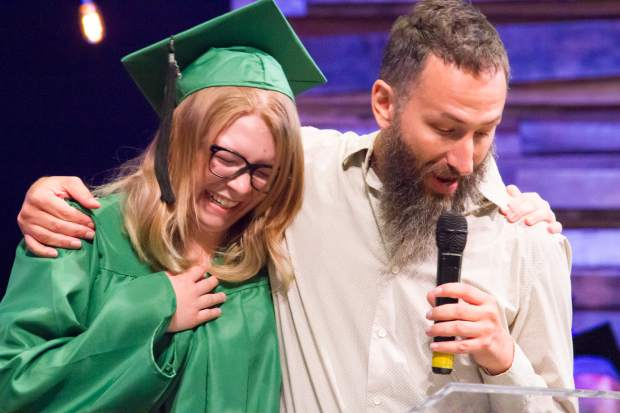 Mary Esbeck receives her diploma from student advisor Ben Green at the Yampah Mountain High School class of 2017 commencement ceremony.