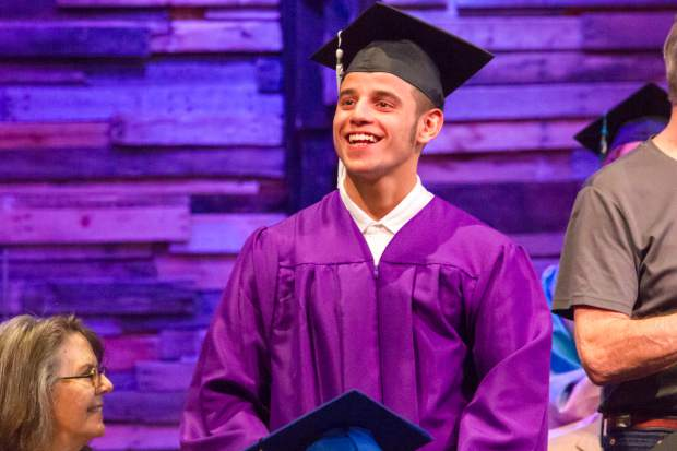 Noah Peterson accepts his Glenwood Springs Rotary Scholarship at the Yampah Mountain High School commencement ceremony on Friday morning.