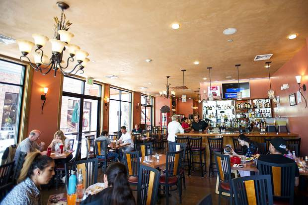 A lunch crowd collects at Hacienda Jalisco on a recent day. The new restaurant offers a menu with a wide variety of dishes.