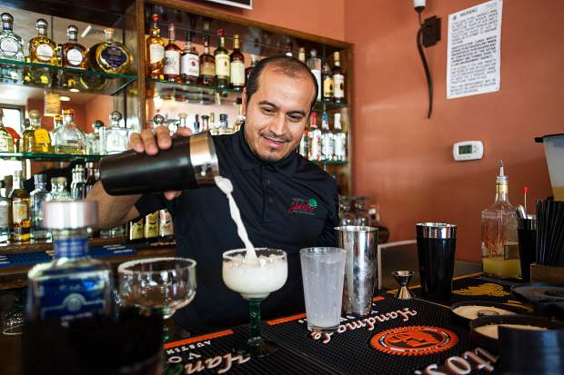 Armando Vidrio, a partner in Hacienda Jalisco in Basalt, makes a coconut margarita one recent day. The restaurant opened at 305 Gold Rivers Court.