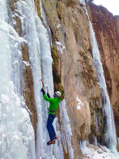 Lynn Sanson climbs Final Curtain in Rifle Mountain Park, a popular ice formation for climbing guide companies.