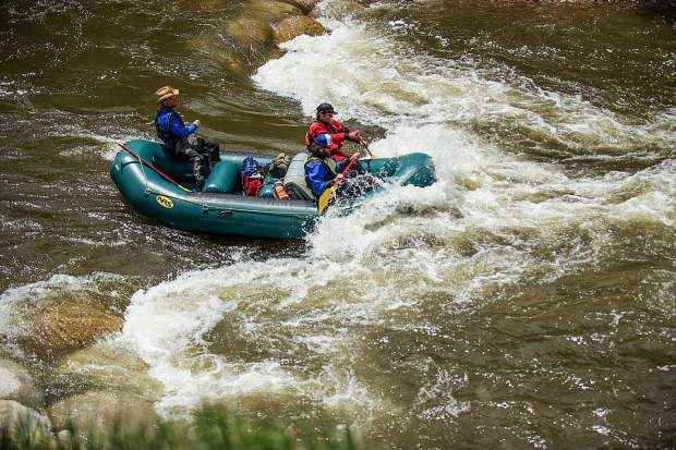 A raft operated by Elk Mountain Expeditions goes through the Basalt wave Tuesday. The rafters are James Foerster is in red, Evan Belkuap in the cowboy hat and Greg Shaffran.