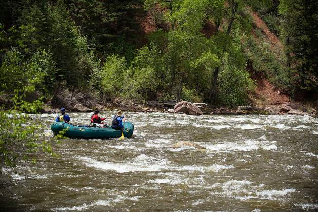 A raft from Elk Mountain Expeditions put in at Wingo Junction on the Roaring Fork River Tuesday for guide training.
