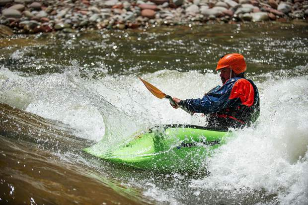 Tom Wills kayaking in the play wave in Basalt on Wednesday.