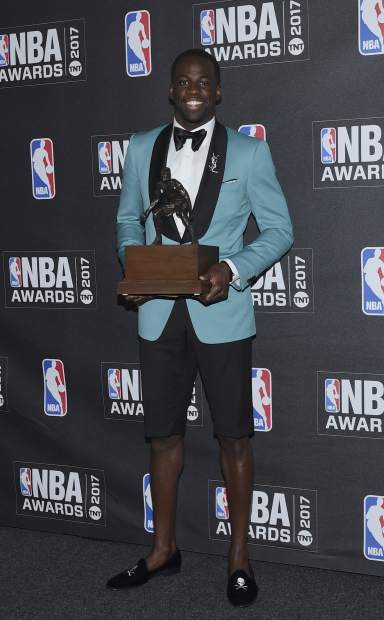 Kia NBA Defensive Player of the Year & Assist of the Year Award winner, Draymond Green, poses in the press room at the 2017 NBA Awards at Basketball City at Pier 36 on Monday, June 26, 2017, in New York. (Photo by Evan Agostini/Invision/AP)