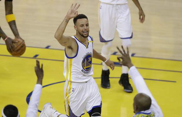 Golden State Warriors guard Stephen Curry (30) gestures after scoring against the Cleveland Cavaliers during the first half of Game 2 of basketball's NBA Finals in Oakland, Calif., Sunday, June 4, 2017. (AP Photo/Marcio Jose Sanchez)