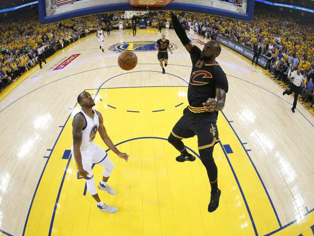 Cleveland Cavaliers forward LeBron James (23) dunks against Golden State Warriors forward Andre Iguodala during the first half of Game 2 of basketball's NBA Finals in Oakland, Calif., Sunday, June 4, 2017. (John G. Mabanglo/Pool Photo via AP)