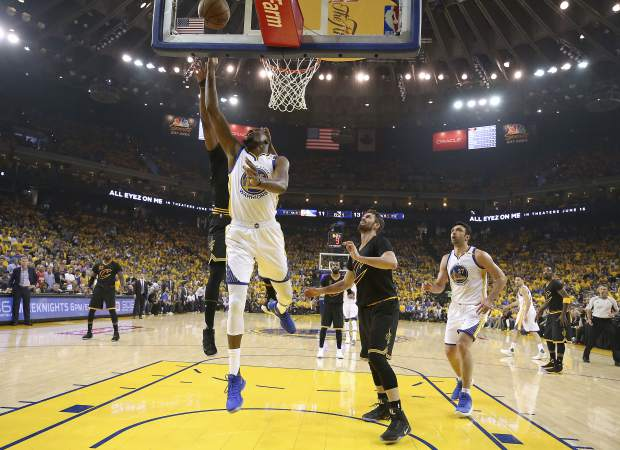 Golden State Warriors forward Kevin Durant shoots against the Cleveland Cavaliers during the first half of Game 2 of basketball's NBA Finals in Oakland, Calif., Sunday, June 4, 2017. (Ezra Shaw/Pool Photo via AP)
