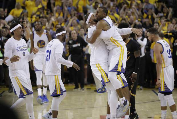 Golden State Warriors players celebrate after beating the Cleveland Cavaliers in Game 5 of basketball's NBA Finals in Oakland, Calif., Monday, June 12, 2017. The Warriors won 129-120 to win the NBA championship. (AP Photo/Marcio Jose Sanchez)
