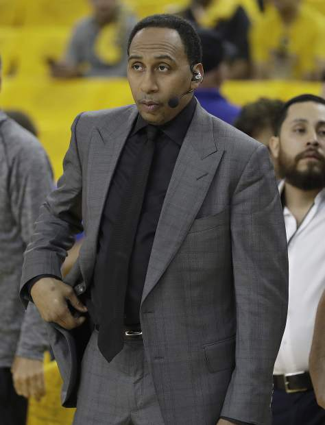 Stephen A. Smith watches as players warm up before Game 5 of basketball's NBA Finals between the Golden State Warriors and the Cleveland Cavaliers in Oakland, Calif., Monday, June 12, 2017. (AP Photo/Marcio Jose Sanchez)