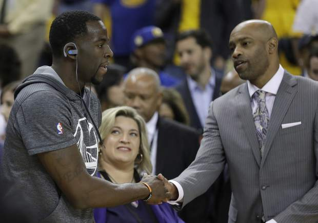 Golden State Warriors forward Draymond Green, left, shakes hands with Vince Carter before Game 5 of basketball's NBA Finals between the Warriors and the Cleveland Cavaliers in Oakland, Calif., Monday, June 12, 2017. (AP Photo/Marcio Jose Sanchez)