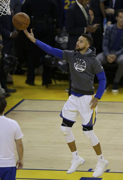 Golden State Warriors guard Stephen Curry warms up before Game 5 of basketball's NBA Finals between the Warriors and the Cleveland Cavaliers in Oakland, Calif., Monday, June 12, 2017. (AP Photo/Ben Margot)