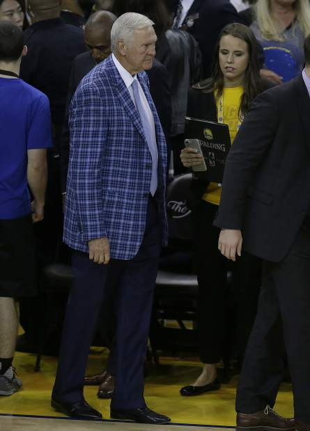 Jerry West walks on the floor before Game 5 of basketball's NBA Finals between the Golden State Warriors and the Cleveland Cavaliers in Oakland, Calif., Monday, June 12, 2017. (AP Photo/Ben Margot)