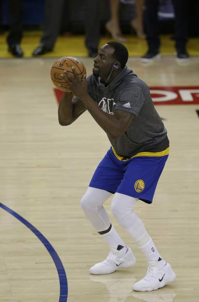 Golden State Warriors forward Draymond Green warms up before Game 5 of basketball's NBA Finals between the Warriors and the Cleveland Cavaliers in Oakland, Calif., Monday, June 12, 2017. (AP Photo/Ben Margot)