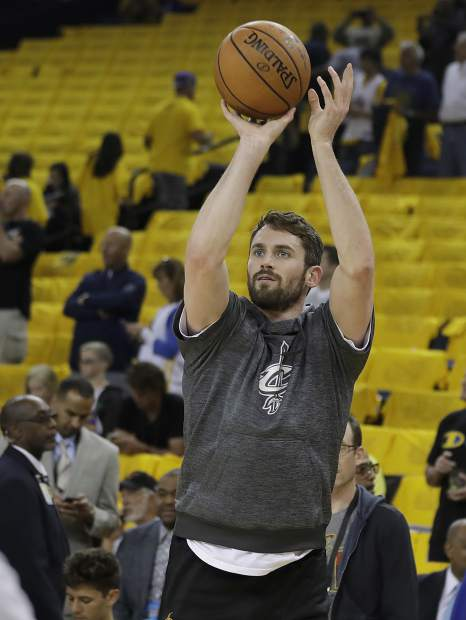 Cleveland Cavaliers forward Kevin Love warms up before Game 5 of basketball's NBA Finals between the Golden State Warriors and the Cavaliers in Oakland, Calif., Monday, June 12, 2017. (AP Photo/Marcio Jose Sanchez)
