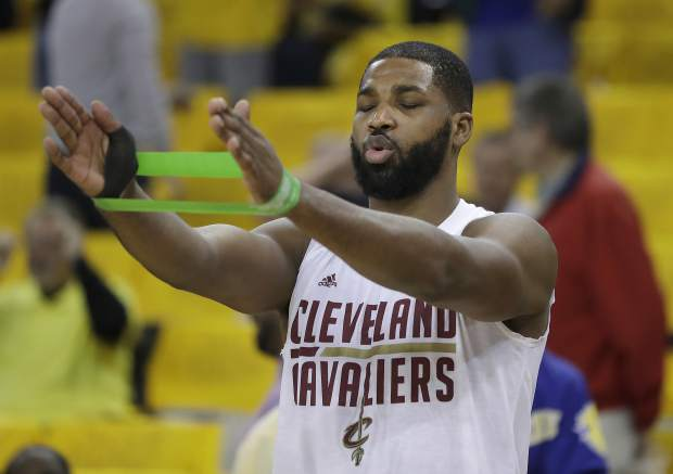 Cleveland Cavaliers center Tristan Thompson warms up before Game 5 of basketball's NBA Finals between the Golden State Warriors and the Cavaliers in Oakland, Calif., Monday, June 12, 2017. (AP Photo/Marcio Jose Sanchez)
