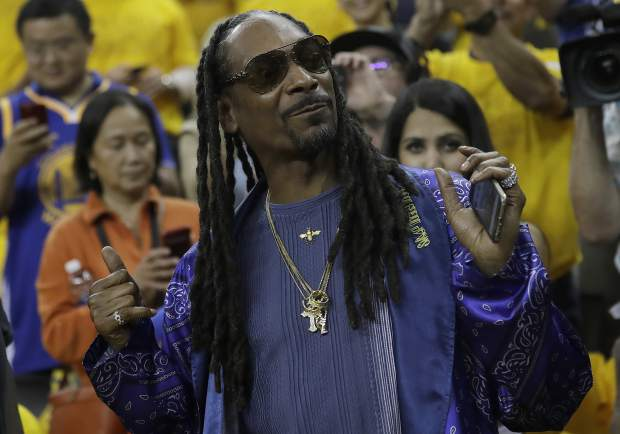 Musician Snoop Dogg poses for photos before Game 5 of basketball's NBA Finals between the Golden State Warriors and the Cleveland Cavaliers in Oakland, Calif., Monday, June 12, 2017. (AP Photo/Marcio Jose Sanchez)