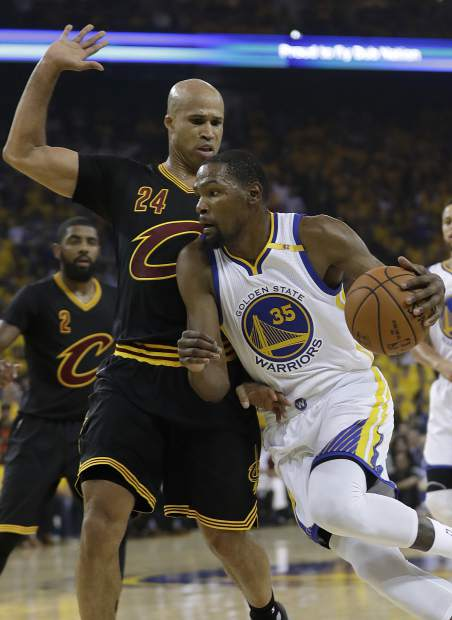 Golden State Warriors forward Kevin Durant (35) dribbles against Cleveland Cavaliers forward Richard Jefferson (24) during the first half of Game 5 of basketball's NBA Finals in Oakland, Calif., Monday, June 12, 2017. (AP Photo/Marcio Jose Sanchez)