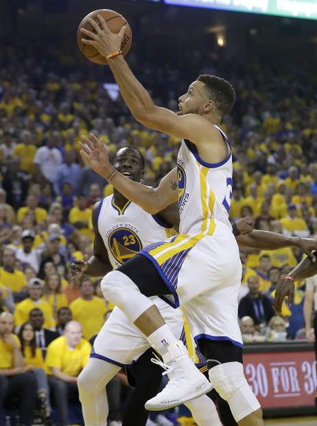 Golden State Warriors guard Stephen Curry shoots against the Cleveland Cavaliers during the first half of Game 5 of basketball's NBA Finals in Oakland, Calif., Monday, June 12, 2017. (AP Photo/Marcio Jose Sanchez)