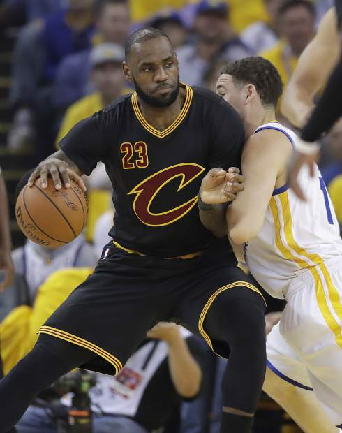 Cleveland Cavaliers forward LeBron James (23) dribbles against Golden State Warriors guard Klay Thompson during the first half of Game 5 of basketball's NBA Finals in Oakland, Calif., Monday, June 12, 2017. (AP Photo/Marcio Jose Sanchez)