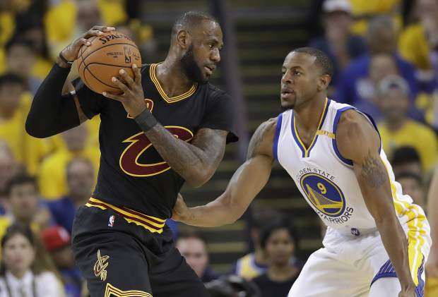 Cleveland Cavaliers forward LeBron James (23) is guarded by Golden State Warriors forward Andre Iguodala (9) during the first half of Game 5 of basketball's NBA Finals in Oakland, Calif., Monday, June 12, 2017. (AP Photo/Marcio Jose Sanchez)