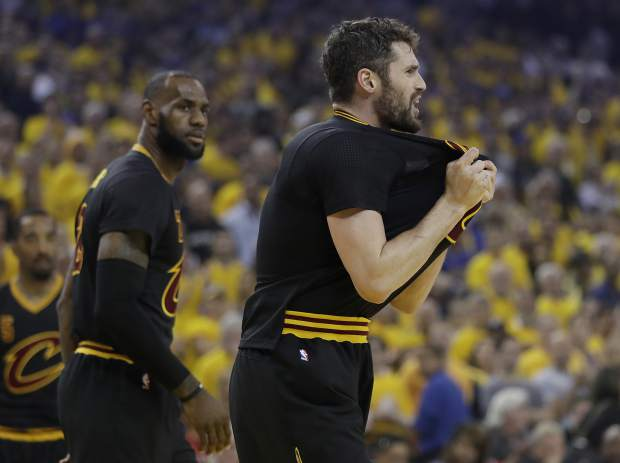 Cleveland Cavaliers forward Kevin Love, right, reacts next to forward LeBron James during the first half of Game 5 of basketball's NBA Finals against the Golden State Warriors in Oakland, Calif., Monday, June 12, 2017. (AP Photo/Marcio Jose Sanchez)