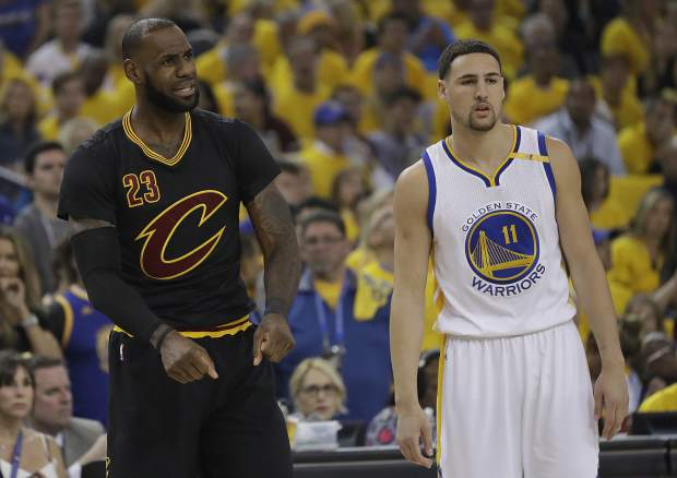 Cleveland Cavaliers forward LeBron James (23) reacts next to Golden State Warriors guard Klay Thompson (11) during the first half of Game 5 of basketball's NBA Finals in Oakland, Calif., Monday, June 12, 2017. (AP Photo/Marcio Jose Sanchez)