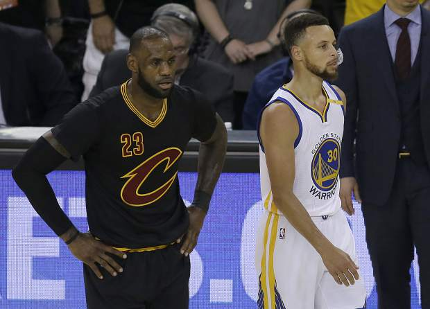 Cleveland Cavaliers forward LeBron James (23) and Golden State Warriors guard Stephen Curry (30) during the first half of Game 5 of basketball's NBA Finals in Oakland, Calif., Monday, June 12, 2017. (AP Photo/Ben Margot)