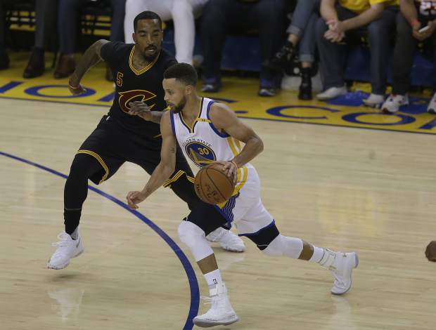 Golden State Warriors guard Stephen Curry (30) drives on Cleveland Cavaliers guard J.R. Smith (5) during the first half of Game 5 of basketball's NBA Finals in Oakland, Calif., Monday, June 12, 2017. (AP Photo/Ben Margot)
