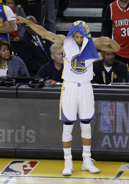 Golden State Warriors guard Stephen Curry (30) gestures during the first half of Game 5 of basketball's NBA Finals against the Cleveland Cavaliers in Oakland, Calif., Monday, June 12, 2017. (AP Photo/Ben Margot)