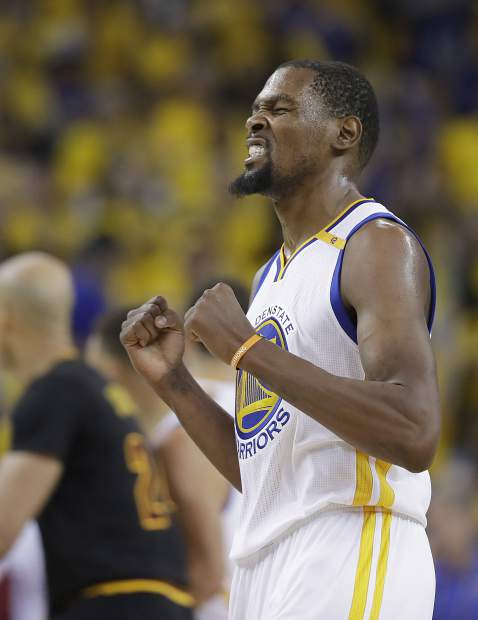 Golden State Warriors forward Kevin Durant reacts after scoring against the Cleveland Cavaliers during the second half of Game 5 of basketball's NBA Finals in Oakland, Calif., Monday, June 12, 2017. (AP Photo/Marcio Jose Sanchez)