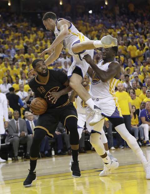 Cleveland Cavaliers center Tristan Thompson (13) shoots again Golden State Warriors guard Klay Thompson, top, and forward Draymond Green during the second half of Game 5 of basketball's NBA Finals in Oakland, Calif., Monday, June 12, 2017. (AP Photo/Marcio Jose Sanchez)
