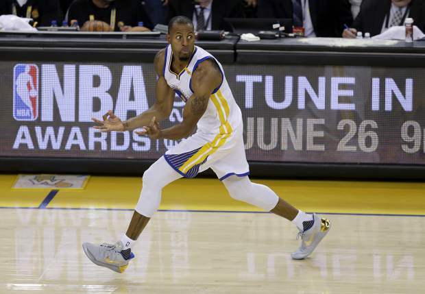 Golden State Warriors forward Andre Iguodala (9) reacts after scoring against the Cleveland Cavaliers during the second half of Game 5 of basketball's NBA Finals in Oakland, Calif., Monday, June 12, 2017. (AP Photo/Ben Margot)